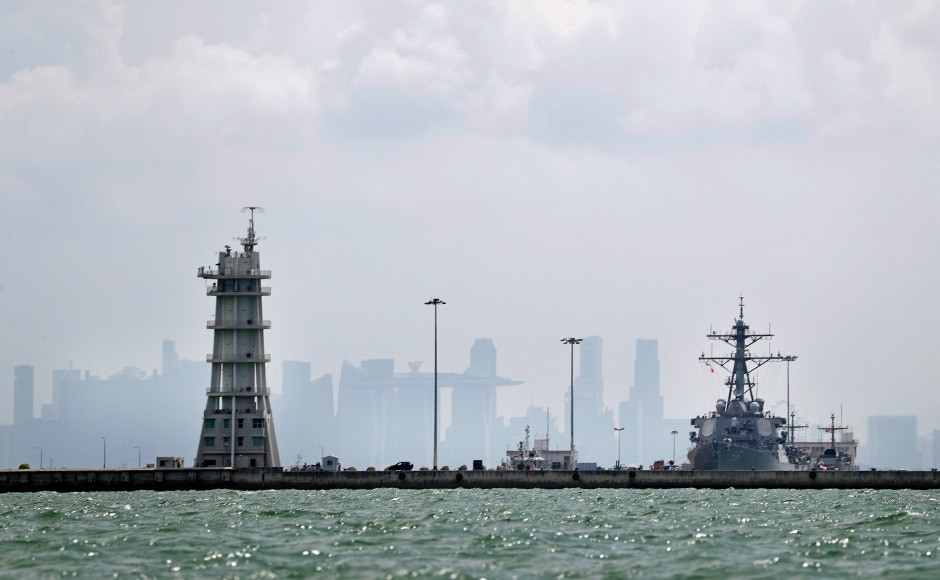 USS John S McCain was escorted back to Singapore and was seen docked at the Changi Naval Base on Monday afternoon. AP