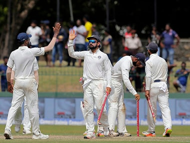 India's captain Virat Kohli celebrates with teammates after their win over Sri Lanka in the second Test. AP