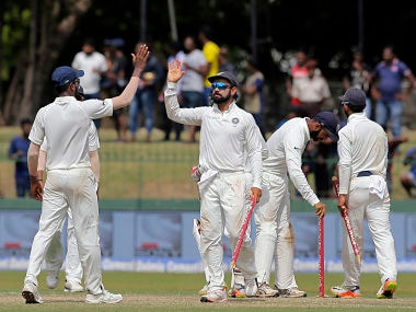 India's captain Virat Kohli, second left, celebrates with teammates after their win over Sri Lanka in their second cricket test match in Colombo, Sri Lanka, Sunday, Aug. 6, 2017. India won the match by an innings and 53 runs. (AP Photo/Eranga Jayawardena)