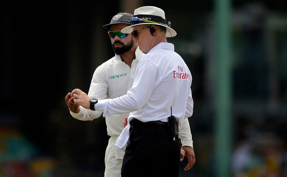 Captain Virat Kohli and umpire Bruce Oxenford inspect the out-of-shape ball during the second innings of the match. The ball was replaced at the start of the 33rd over.  AP