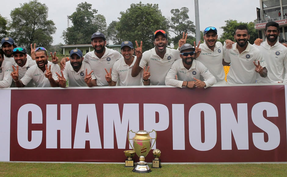 Indian cricket team pose with the winners trophy after they complete a 3-0 whitewash over Sri Lanka. Their first ever on foreign soil. AP