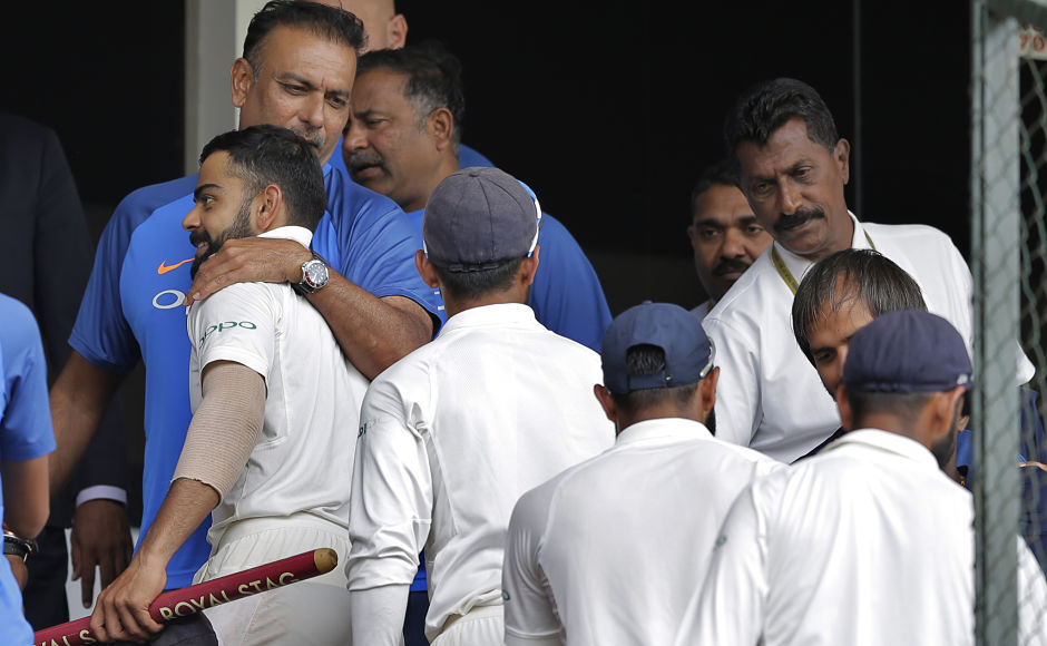 After dismissing Sri Lanka for 181 the Indian side won the match by an innings and 171-runs. Indian cricket team coach Ravi Shastri hugs to congratulate captain Virat Kohli after the win. AP