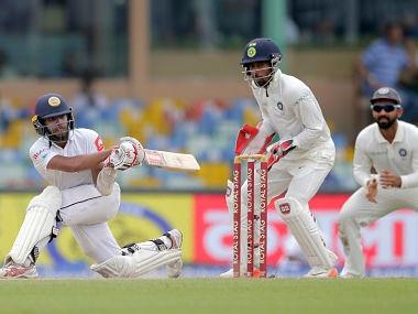 Sri Lanka's Kusal Mendis, left, plays a shot during their second cricket test match against India in Colombo, Sri Lanka, Saturday, Aug. 5, 2017. (AP Photo/Eranga Jayawardena)