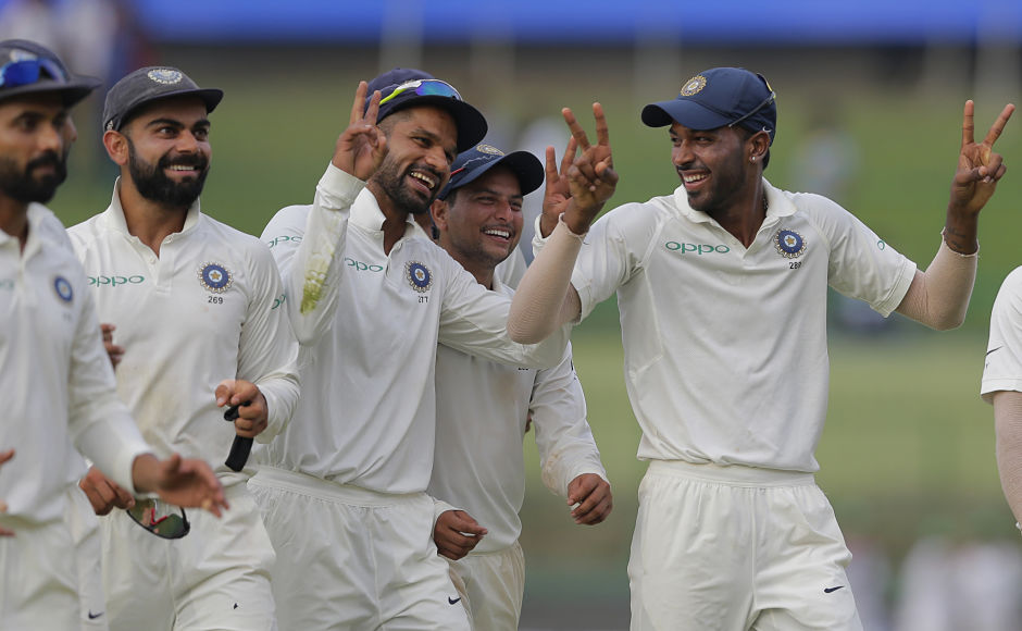 Centurions – Shikhar Dhawan and Hardik Pandya – share a light moment at stumps of Day 2 as India are 9 wickets away from completing a series whitewash 3-0. AP