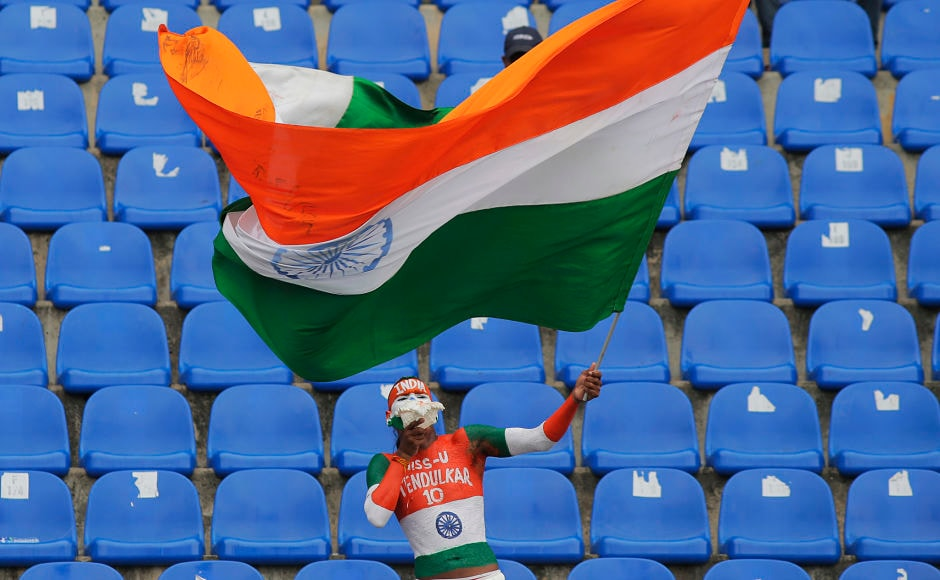 The devout Indian cricket fan – Sudhir Kumar Gautam – waved the tricolor national flag after India's win over Sri Lanka. AP