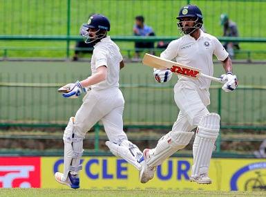 India's Shikhar Dhawan, right, and Lokesh Rahul run between the wickets during the first day's play of their third cricket test match against Sri Lanka in Pallekele, Sri Lanka, Saturday, Aug. 12, 2017. (AP Photo/Eranga Jayawardena)