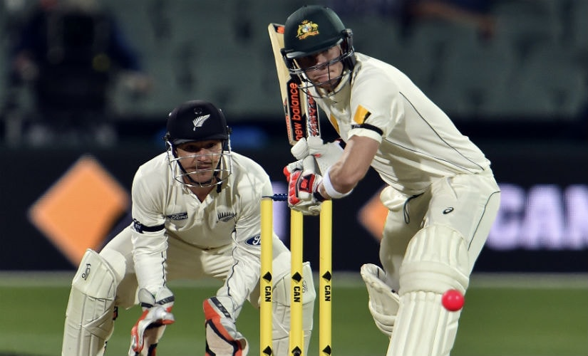 Australia captain Steve Smith plays a shot as New Zealand wicketkeeper BJ Watling looks on in the inaugural day-night Test. AFP