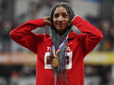 Nafissatou Thiam poses with her gold medal at the presentation ceremony in London on Sunday. Reuters