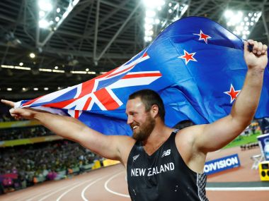 Tomas Walsh of New Zealand celebrates after winning the men's shot put final. Reuters