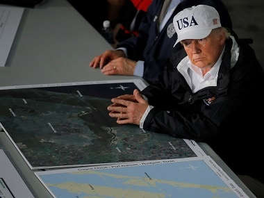 Donald Trump receives briefing on Harvey. Reuters