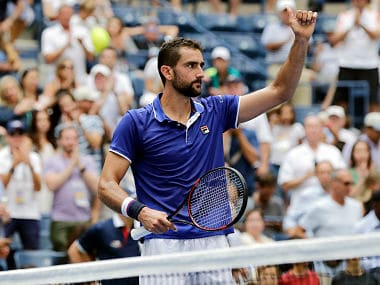 Marin Cilic, of Croatia, waves to spectators after defeating Tennys Sandgren, of the United States, during the first round of the U.S. Open tennis tournament, Monday, Aug. 28, 2017, in New York. (AP Photo/Seth Wenig)