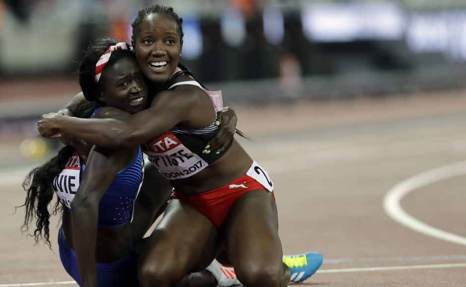 United States' Tori Bowie, left, celebrates with Trinidad and Tobago's Kelly-Ann Baptiste after winning the gold medal in the Women's 100m final during the World Athletics Championships in London Sunday. AP