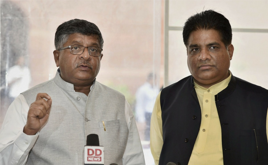 Union Law Minister Ravi Shankar Prasad and BJP national general secretary Bhupendra Yadav talk to media during the ongoing monsoon session of Parliament, in New Delhi on Thursday. PTI