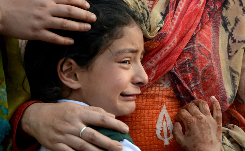 Zohra, daughter of deceased police officer Abdul Rasheed, who was killed in a shootout with suspected rebels, during the funeral at the police headquarters in Srinagar on Monday. PTI