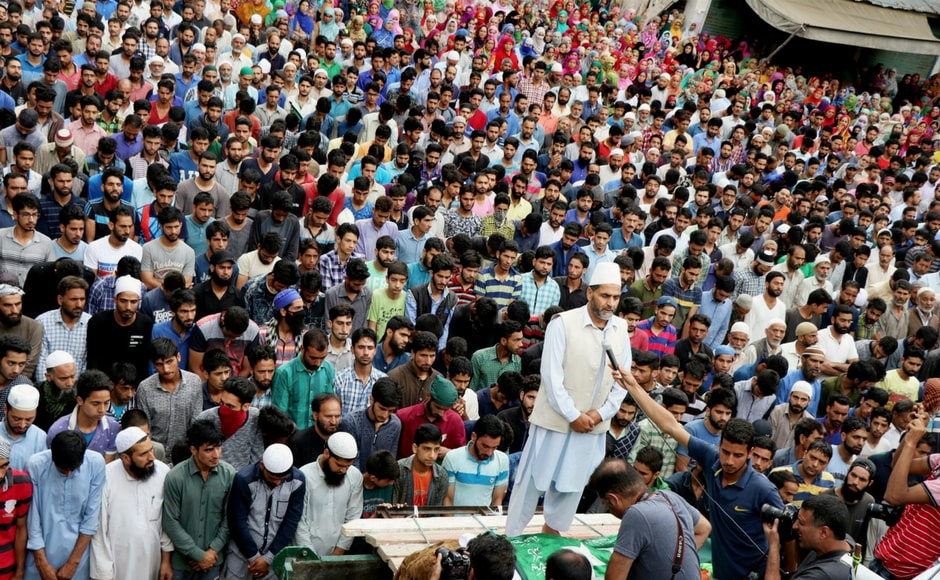 People offering funeral prayers for a civilian who was killed during Tuesday's clashes between security forces and protesters following the killing of LeT commander Abu Dujana, at Gabarpora village of Pulwama district on Wednesday. PTI
