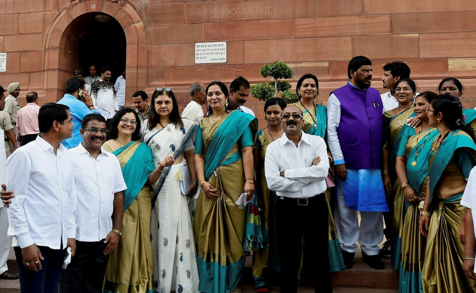 Union ministers Maneka Gandhi and Ramdas Athawale with the members of human rights organisations during the ongoing Monsoon Session of Parliament, in New Delhi on Thursday. PTI