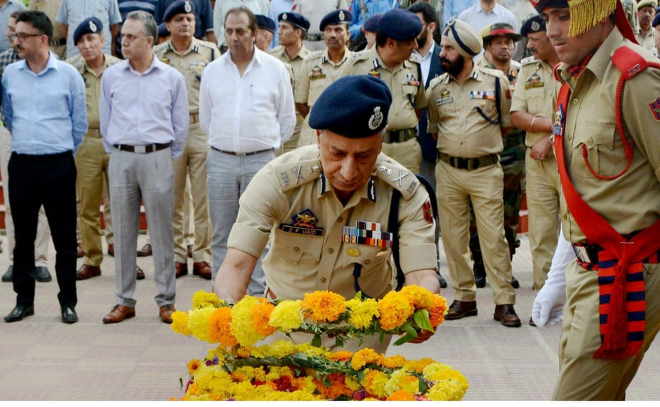 Director General of Jammu and Kashmir Police SP Vaid pays floral tribute to deceased officer ASI Abdul Rashid in Srinagar on Monday. PTI