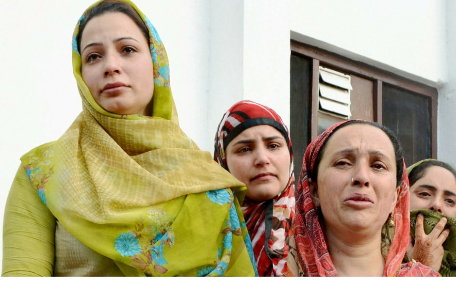 Family members of Rashid mourn his death in Anantnag of Srinagar on Monday. PTI
