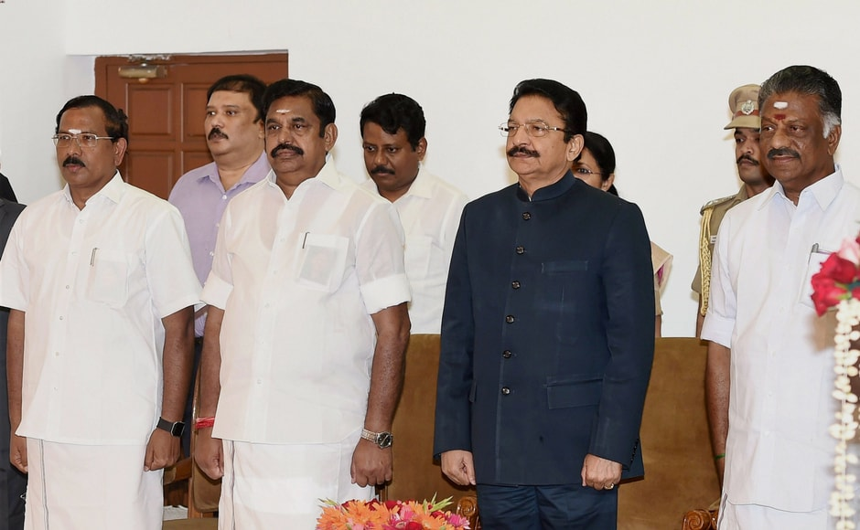 Tamil Nadu governor CH Vidyasagar Rao (second from right) and Chief Minister K Palaniswamy (second from left) with newly sworn-in deputy chief minister O Panneerselvam (R) at Raj Bhavan in Chennai on Monday. Pannerselvam was made the coordinator of the merged AIADMK while Palaniswamy will be the joint coordinator, the chief minister announced at a brief event at the party headquarters. PTI
