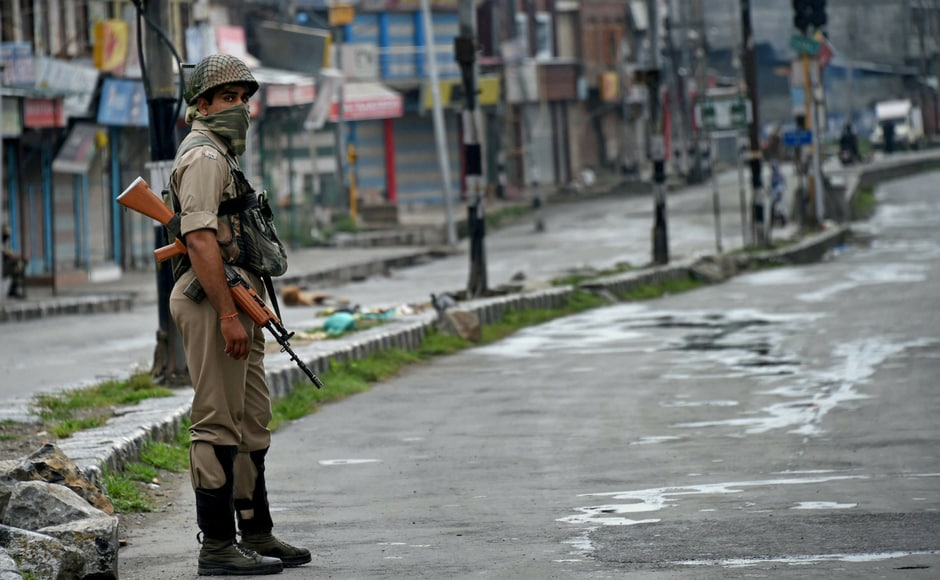 A security personnel stands guard during restrictions and strike in Downtown Srinagar on Wednesday. Authorities imposed restrictions as the separatists called for a fresh strike following the killings of two top Lashkar-e-Toiba militants and a civilian in Pulwama. PTI