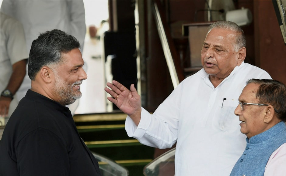 SP chief Mulayam Singh Yadav with Jan Adhikar Party chief and MP Rajesh Ranjan alias Pappu Yadav during the ongoing monsoon session of Parliament, in New Delhi on Thursday. PTI