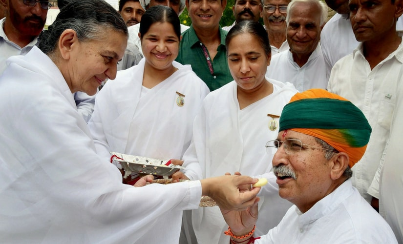 Brahma Kumaris tie rakhi and offer sweets to Union Minister of State for Finance Arjun Ram Meghwal on Raksha Bandhan, in Bikaner on Monday. President Ram Nath Kovind and Vice-President Hamid Ansari on Sunday had greeted the people on Raksha Bandhan. PTI