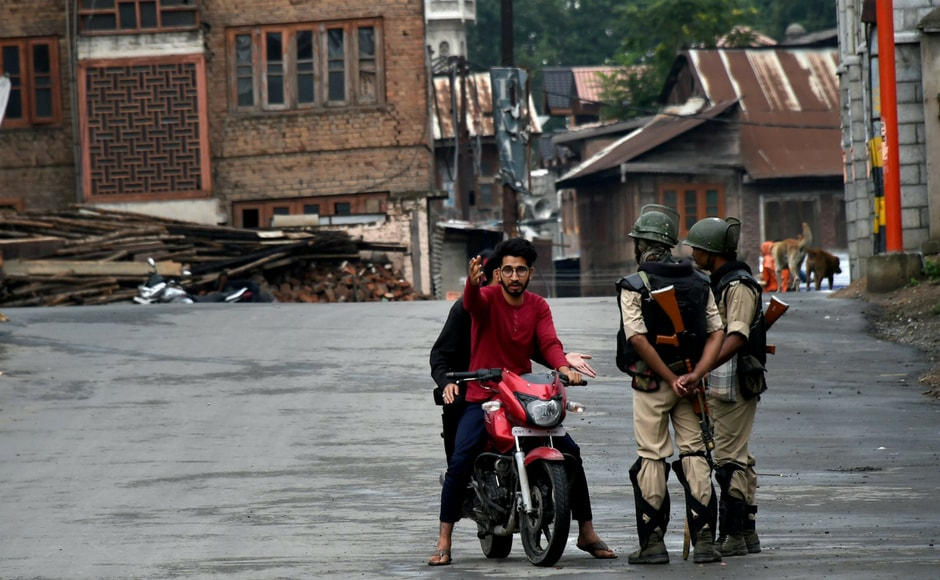 Security personnel stop a motorcyclist during restrictions and strike in Srinagar on Wednesday. Authorities imposed restrictions as the separatists called for a fresh strike following the killings of two top Lashkar-e-Toiba militants and a civilian in Pulwama. PTI