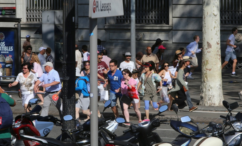 The late afternoon attack in the city's Las Ramblas district left victims sprawled in the historic street, spattered with blood or writhing in pain from broken limbs. AP