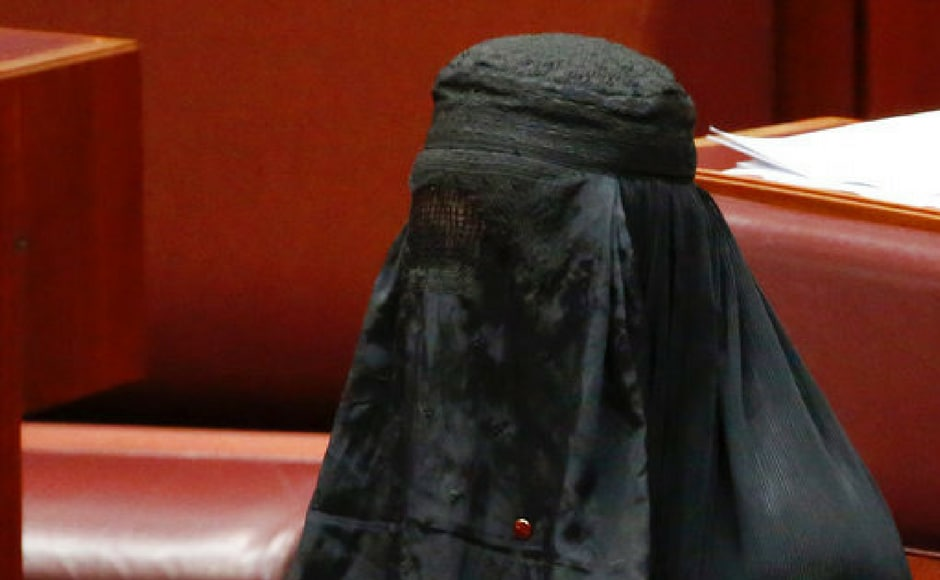 Senator Pauline Hanson rises to speak while wearing a burqa during question time in the Senate chamber at Parliament House in Canberra, Australia on Thursday. AP
