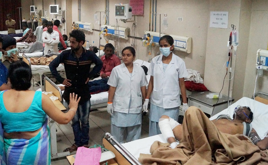 Injured people are attended to at a hospital in Meerut on Saturday. The Indian Red Cross Society sent 100 units of blood to the Meerut Medical College Hospital near Khatauli, where most of the injured are being treated. PTI
