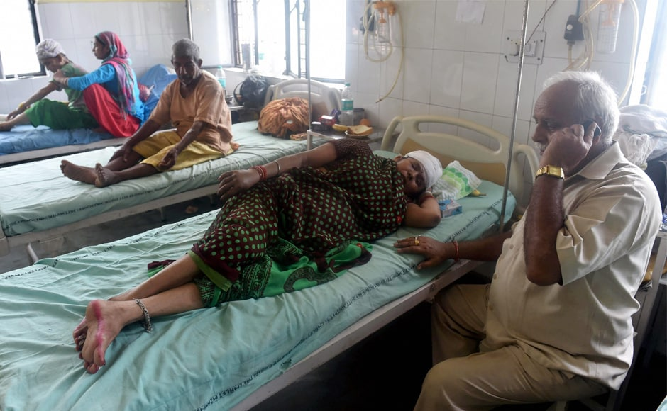 Passengers being treated at Muzaffarnagar district hospital on Sunday. Passengers reeled with shock while witnesses said, in some cases, despite calls for help, they couldn't reach the people in the coach which made it difficult to bring them out alive. PTI