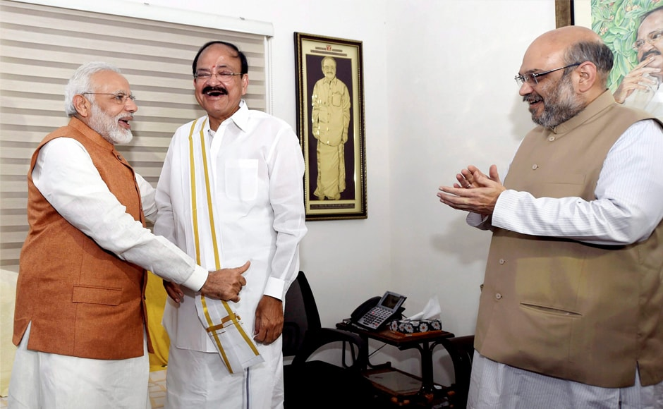 Prime Minister Narendra Modi and BJP president Amit Shah greet Vice-President-elect Venkaiah Naidu at his residence in New Delhi on Saturday. Although 785 MPs were eligible to vote in the election, 14 MPs could not vote. PTI