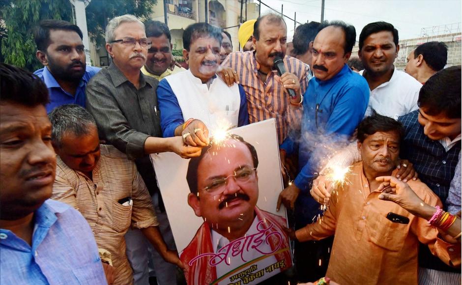 BJP workers celebrate the victory of NDA candidate Venkaiah Naidu's victory, in Bhopal on Saturday. PTI