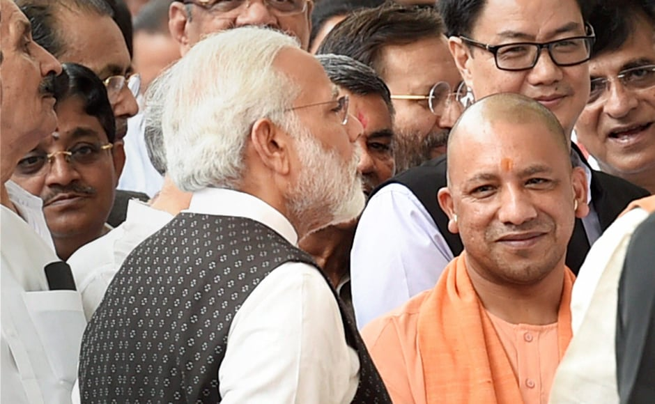 Prime Minister Narendra Modi and Uttar Pradesh Chief Minister Yogi Adityanath during the Vice Presidential election in the Parliament house, New Delhi. Modi congratulated Naidu on Twitter saying he is confident Naidu will 'serve the nation as a diligent and dedicated Vice President'. PTI