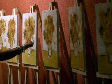 A painter draws imitation of van Gogh's 'Sunflower'. Reuters.