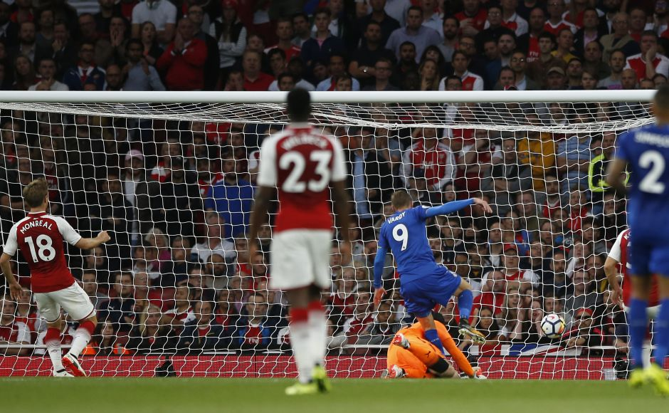 England striker Jamie Vardy put Leicester 2-1 ahead just before the half hour, darting into the box to rifle another fine Marc Albrighton cross past Petr Cech. AP