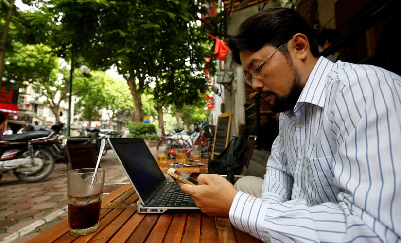 Vietnamese activist Anh Chi searches the Internet at Tu Do (Freedom) cafe in Hanoi, Vietnam. Reuters