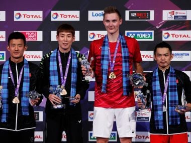 Viktor Axelsen poses as he celebrates his win in the final against Lin Dan with his medal. Reuters