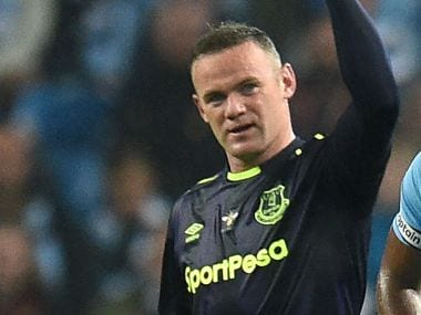 Wayne Rooney has survived difficult times to become only the second player to score 200 Premier League goals. AFP