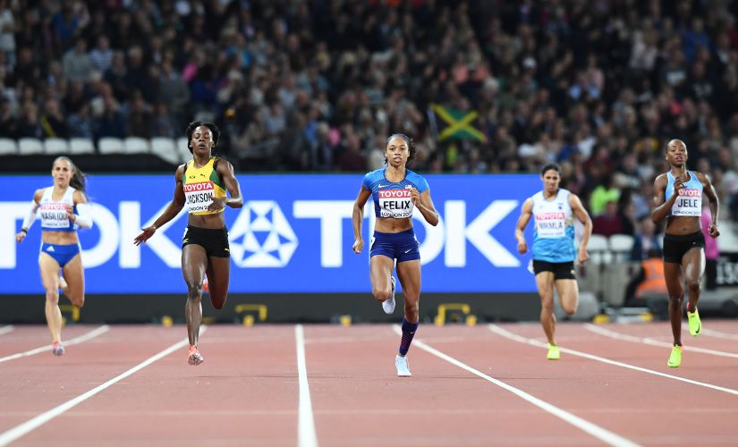 US athlete Allyson Felix (C) competes in the semi-finals of the women's 400m athletics event. India's Nirmala Sheron runs in the lane next to her. AFP
