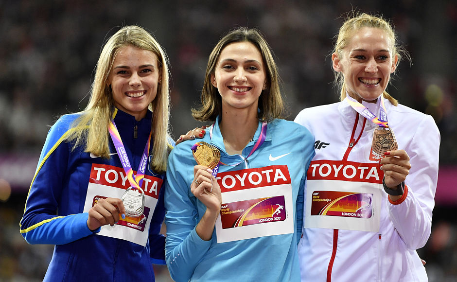 Maria Lasitskene became the first Russian to win a gold medal at the World Championships after successfully defending her high jump gold. Ukraine's Yuliia Levchenko(L) and Poland's Kamila Licwinko(R) won the silver and bronze medals. AP