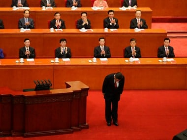 Chinese President Xi Jinping bows before delivering a speech at a ceremony to commemorate the 90th anniversary of the founding of the People's Liberation Army at the Great Hall of the People in Beijing on Tuesday. AP