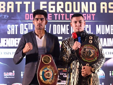 WBO Asia-Pacific Super Middleweight champion Vijender Singh and his competitor WBO Oriental Super Middleweight champion Zulpikar Maimaitiali. AFP