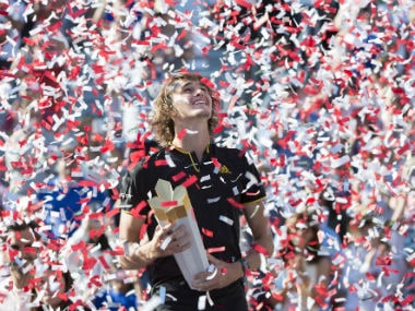 Confetti falls over Alexander Zverev, of Germany, during victory ceremonies after he defeated Roger Federer, of Switzerland, in the final at the Rogers Cup. AP