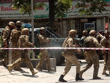 Security forces at site of attack. AP