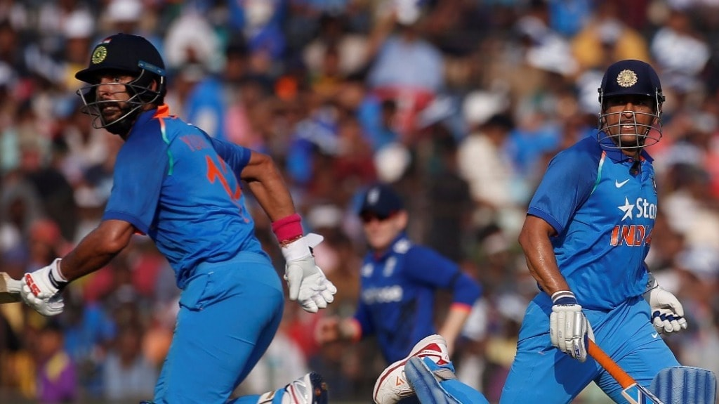Yuvraj Singh (L) and Mahendra Singh Dhoni run between the wickets during the 2nd ODI of the series against England at Cuttack in January 2017. Reuters