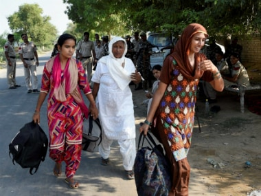 Sirsa: Baba Ram Rahim Gurmeet Singh's followers leave Dera and going back to their homes, peacfully in Sirsa on Sunday.PTI