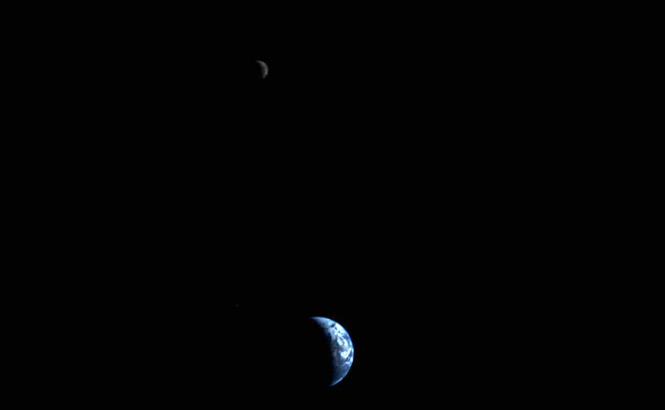 The Earth and the Moon, the first such image taken by a spacecraft. Image: NASA.