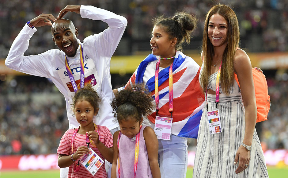 One of the greatest distant-runners, men's 5000m silver medalist Britain's Mo Farah, poses with his family on the podium following the medal ceremony. AP