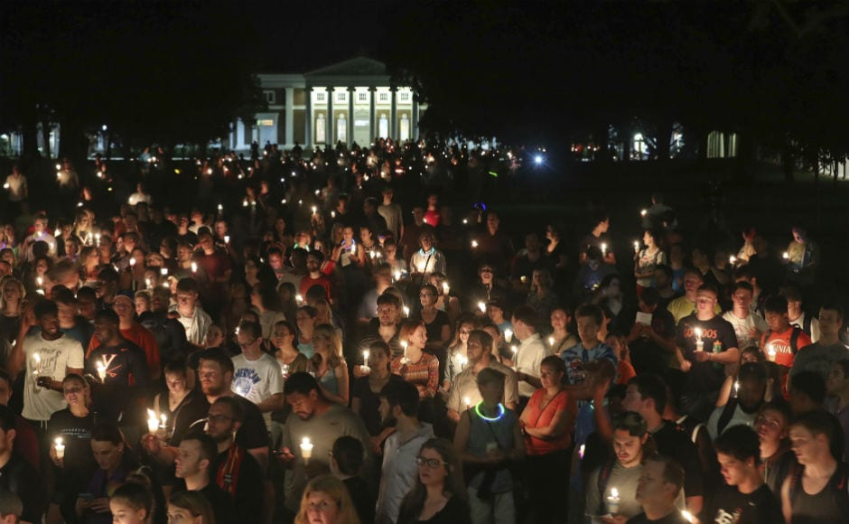 Hundreds of people marched peacefully with lit candles across the University of Virginia campus on 16 August, 2017, in Charlottesville, in the wake of violence in the city, and against white nationalist parade in the same campus in last week. AP